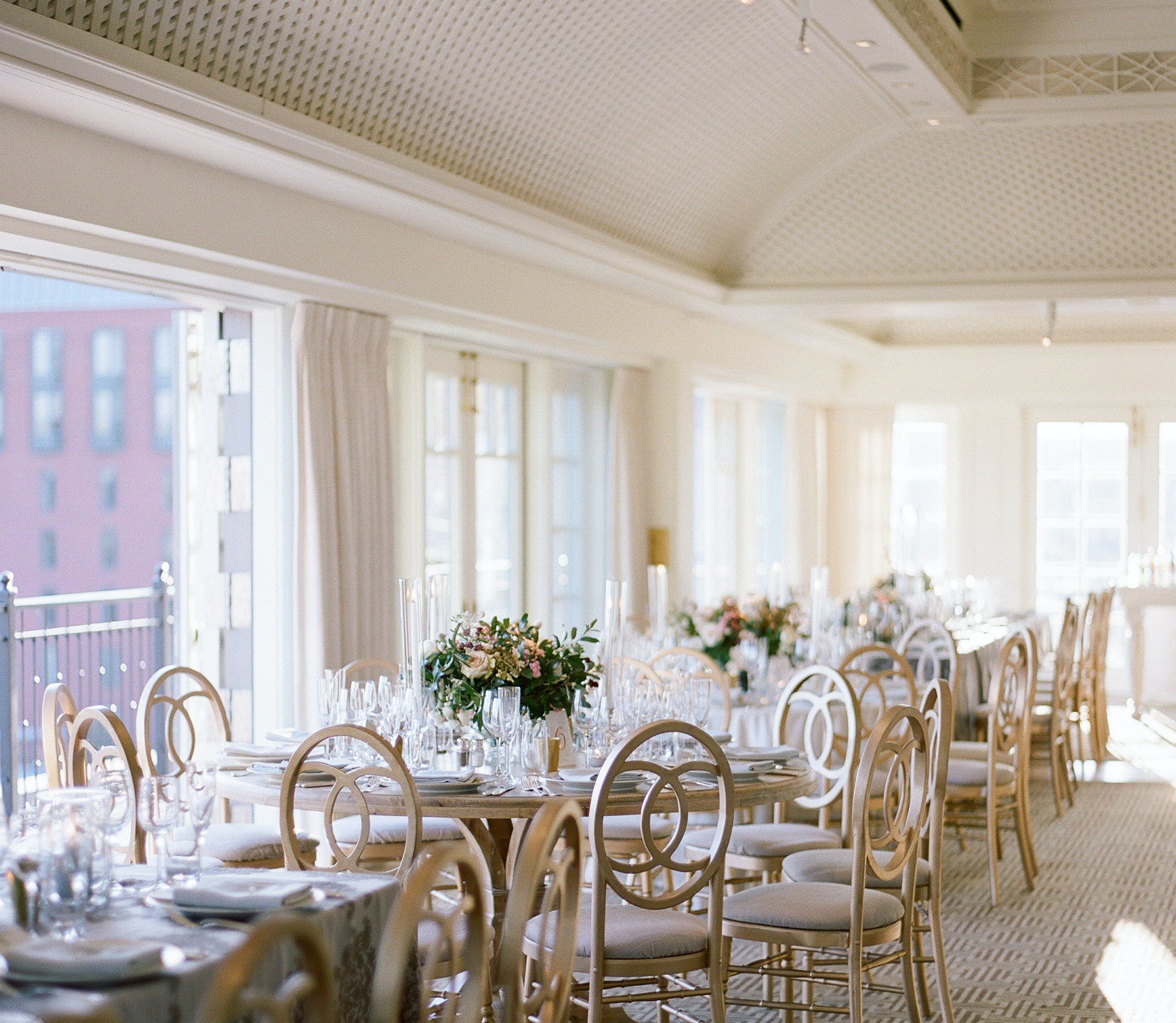 neutral cream colored ballroom with tall windows offering bright views at Hay-Adams washington, d.c.