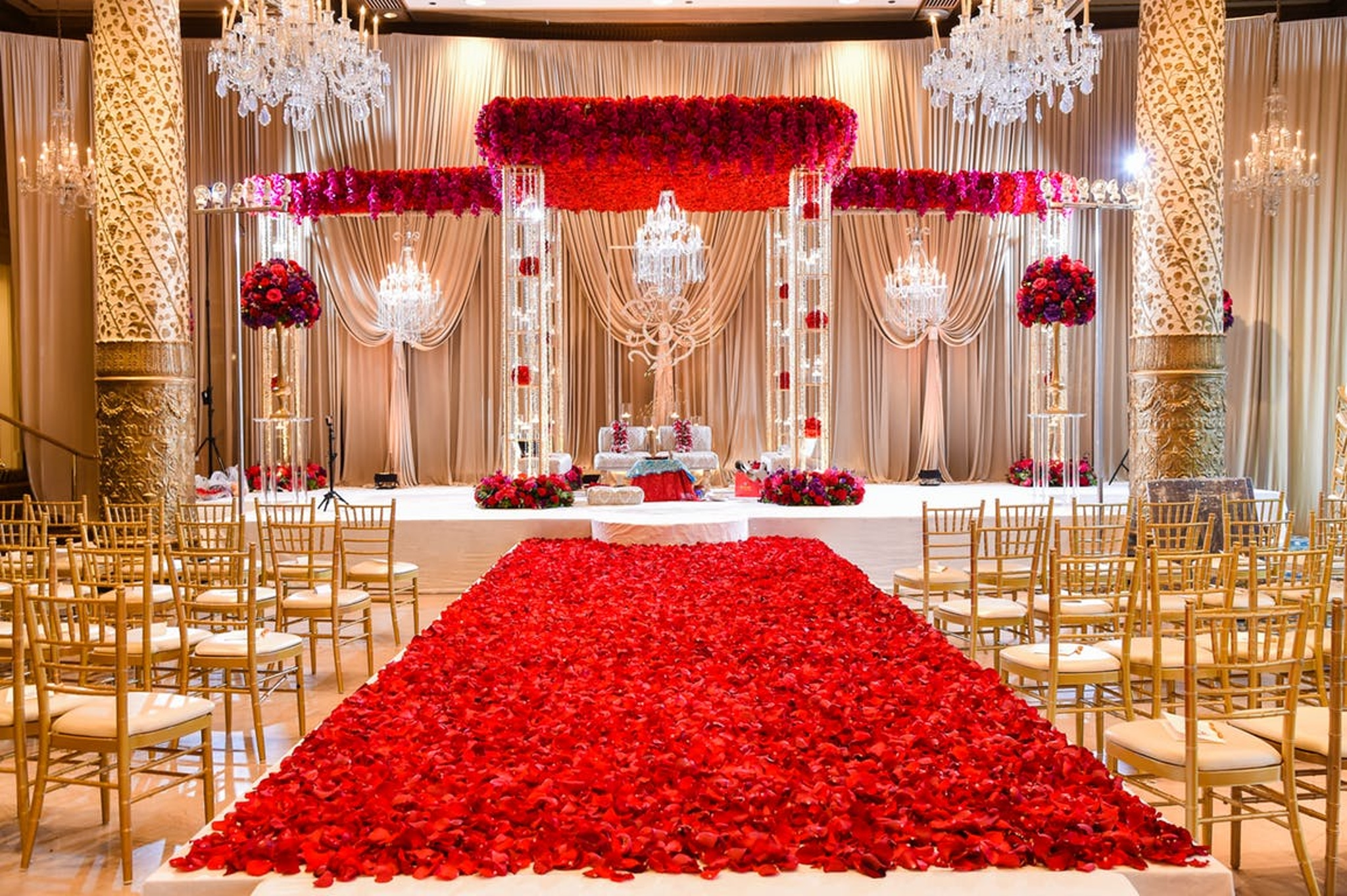 Red flowers and gold chairs at wedding in The Drake Hotel Chicago