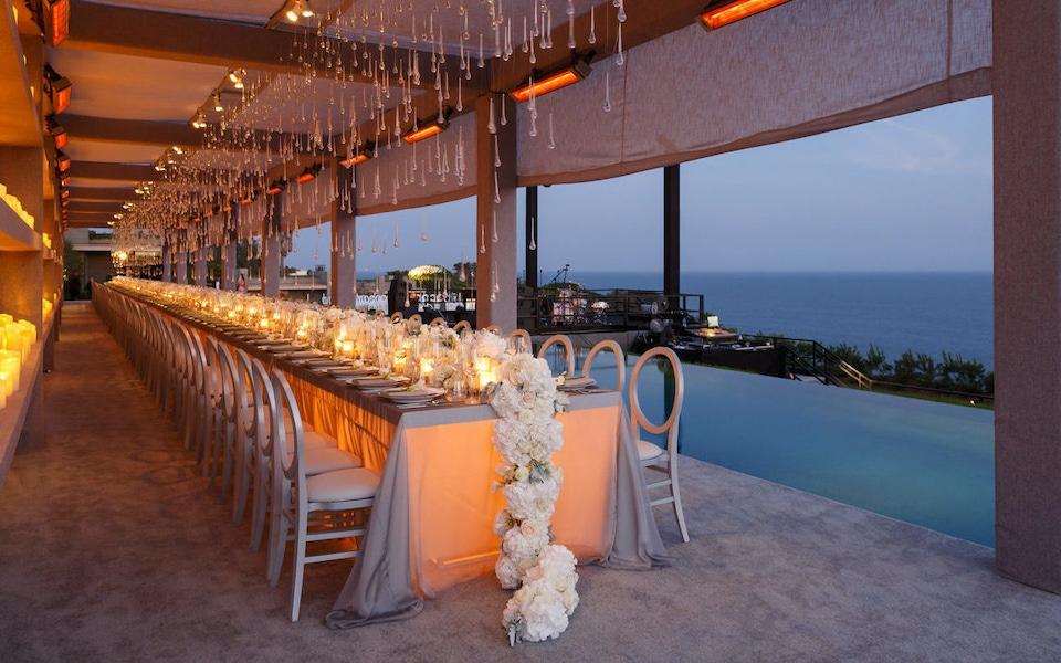 Malibu white floral candlelit table arrangement