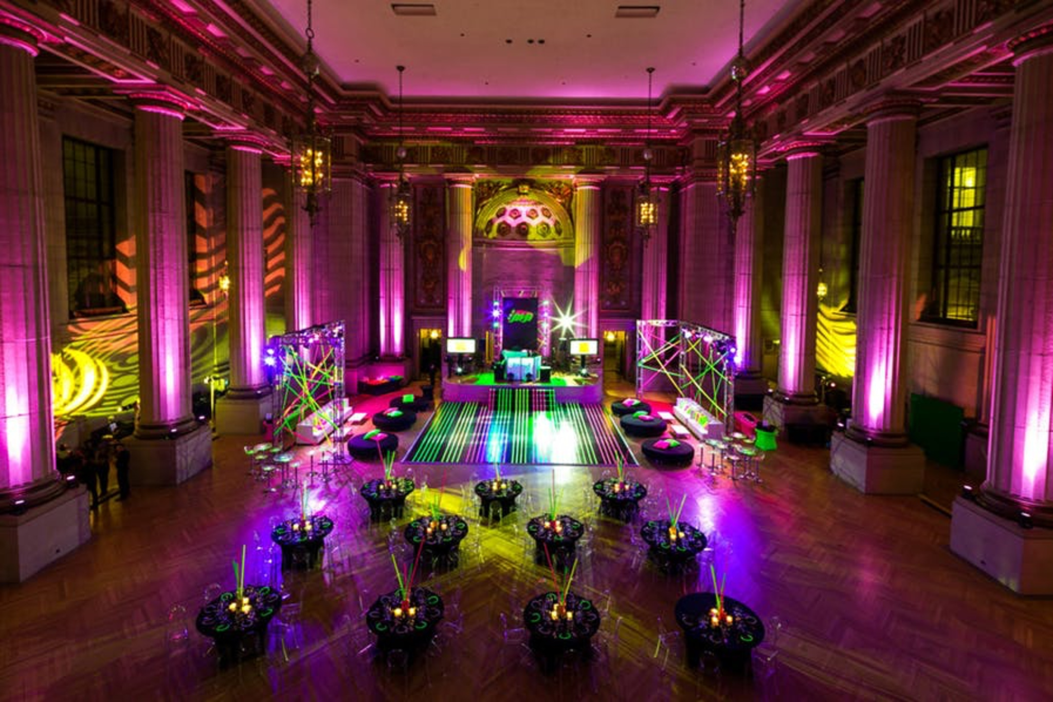 dramatic violet lighting illuminates the two-story andrew w. mellon auditorium event space