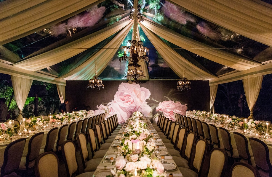 Large pink rose decoration in tent