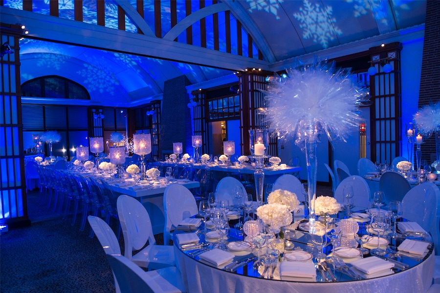 Blue lit room with white centerpieces
