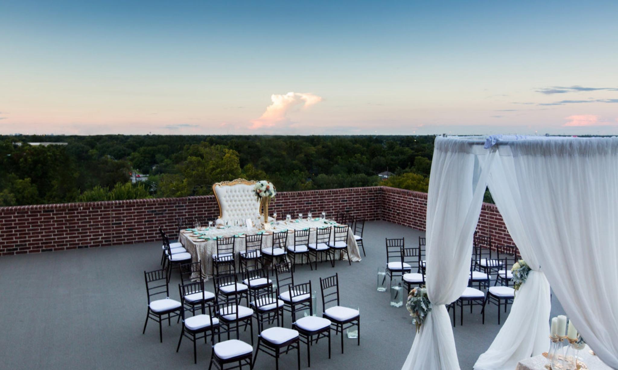 Rooftop wedding in front of the sunset at 111 Studewood Place