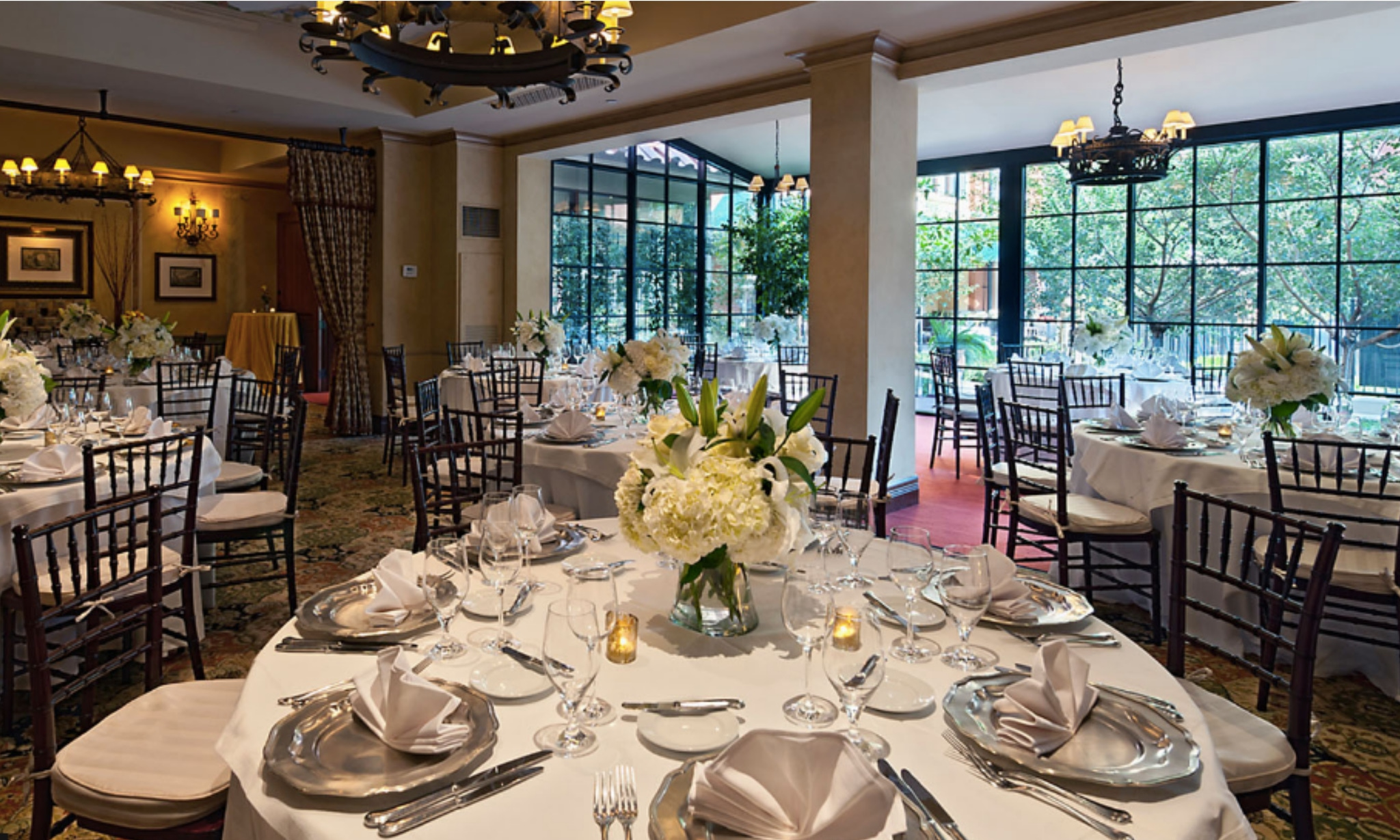 Party table setting with white florals and silver silverware