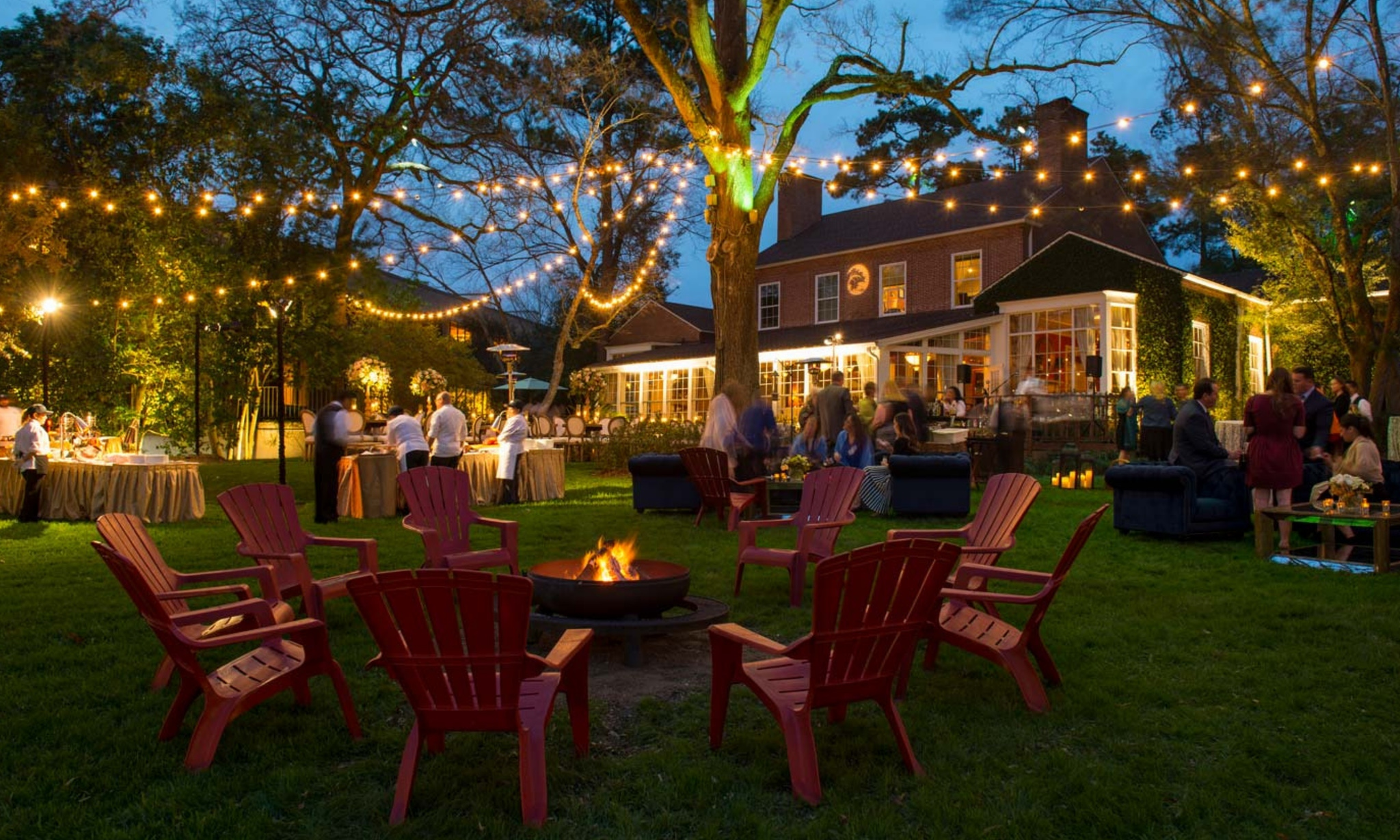 Twinkling lights and red chairs outside in Houston