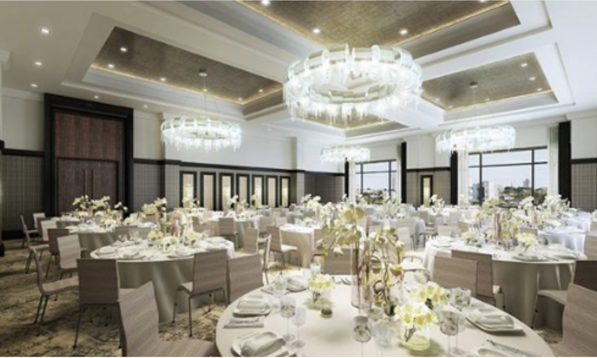 Crystal chandeliers, white table decor and florals at Post Oak Hotel Houston