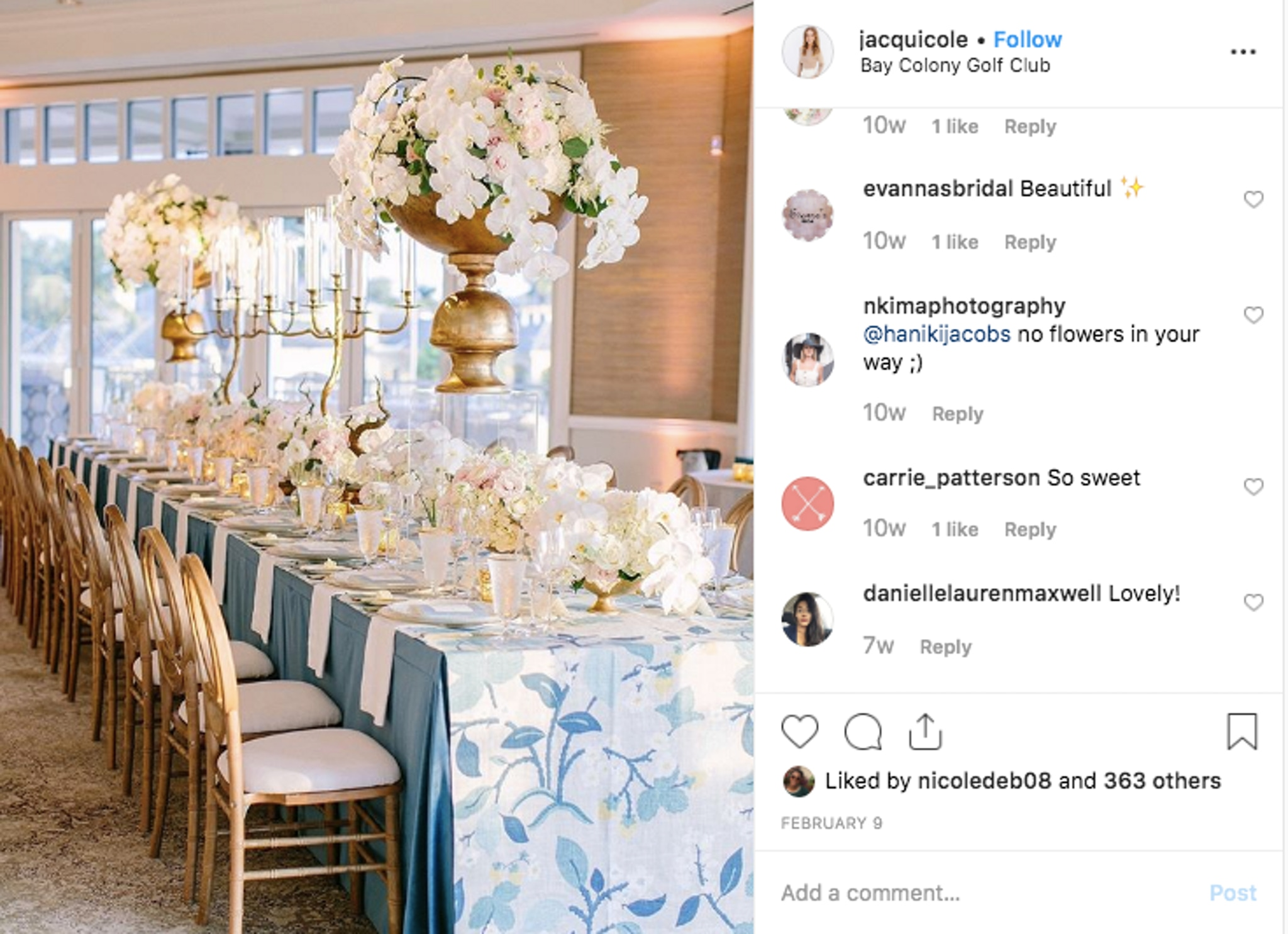 wedding table decor with gold chairs, white floral arrangements and a blue floral table cloth