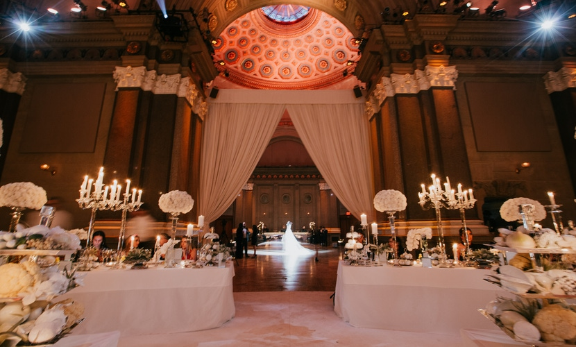 Elegant ballroom venue with large white curtains