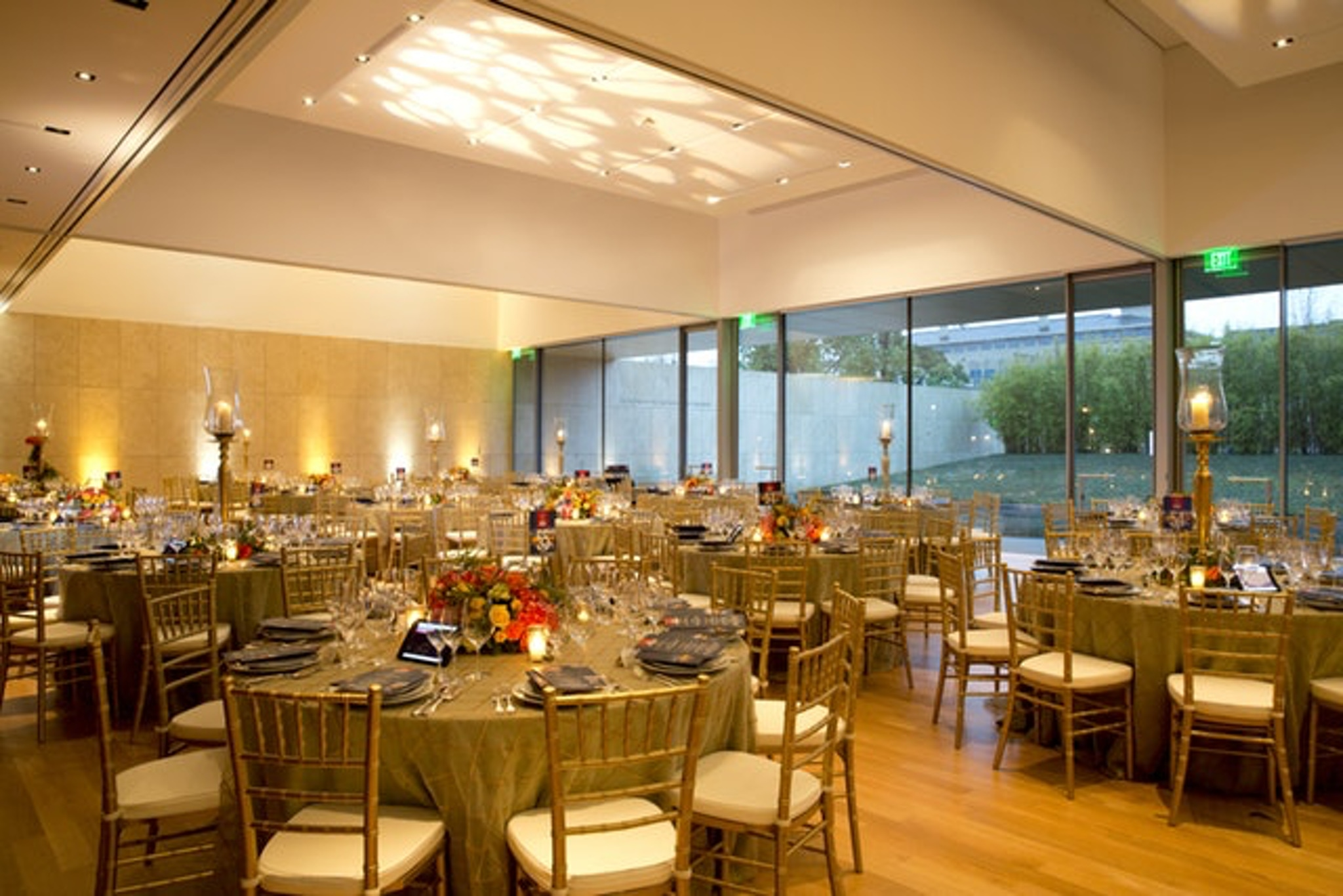 Gold chairs and table scape at Asia Society Texas Center