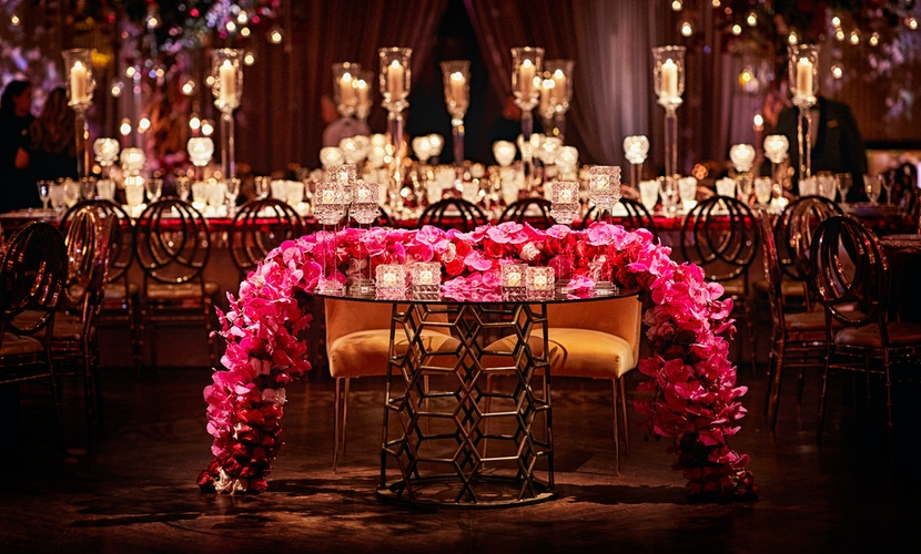 pink florals draping bride and groom table and candle centerpieces