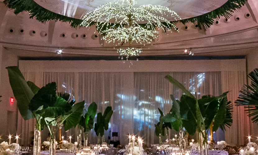 Wedding centerpiece leaves and greenery and chandelier