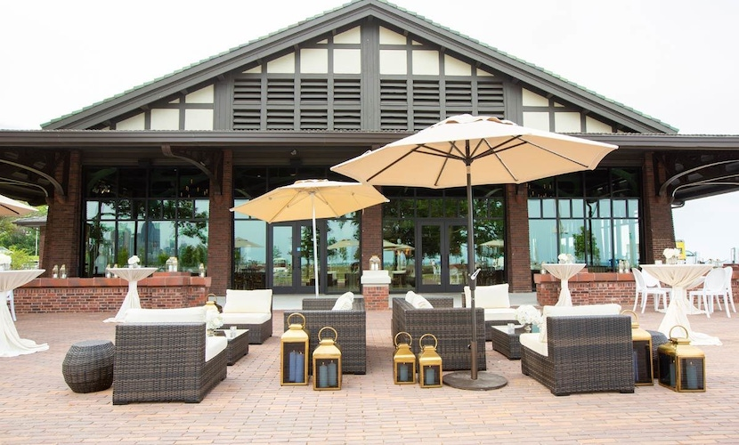 Outdoor patio with brown and white sofas and umbrellas