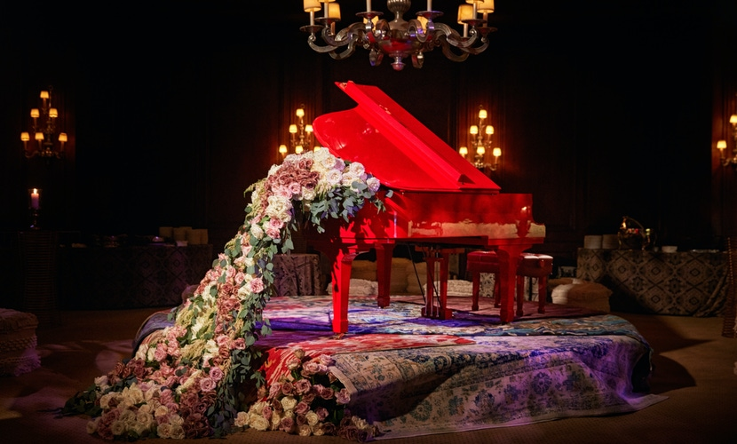 Red piano with florals and rugs