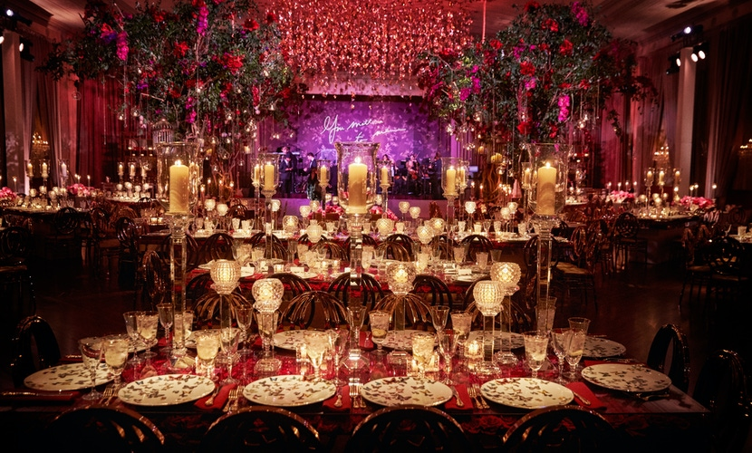 gold and pink wedding decor accents and candles and butterflies
