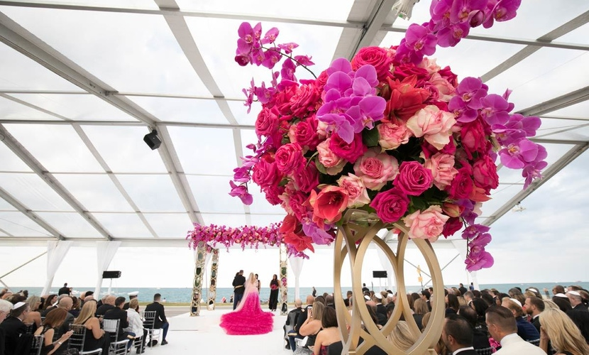 Pink roses and floral arrangements at wedding