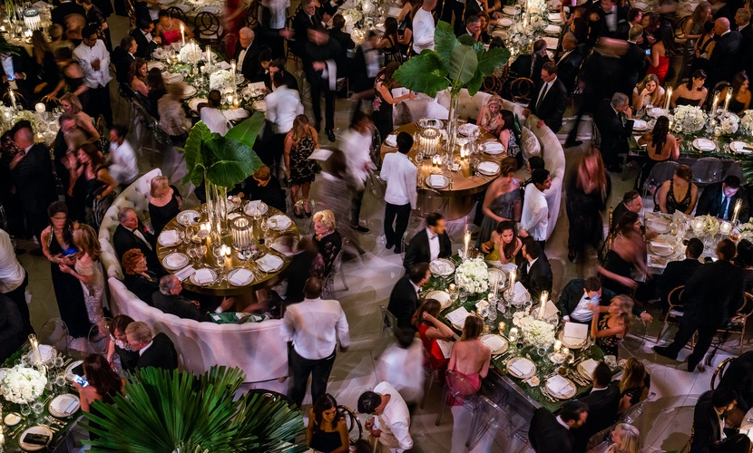 Guests at green and white wedding ceremony