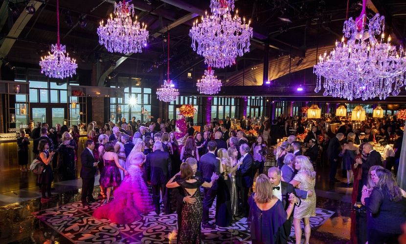 Crystal chandeliers and wedding guest at spacious venue