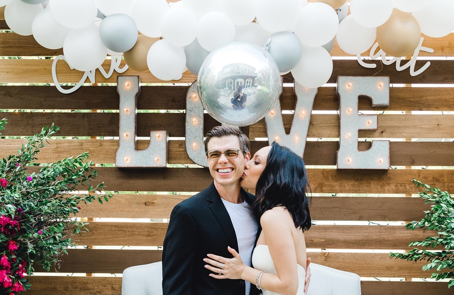 Couple in front of a love sign