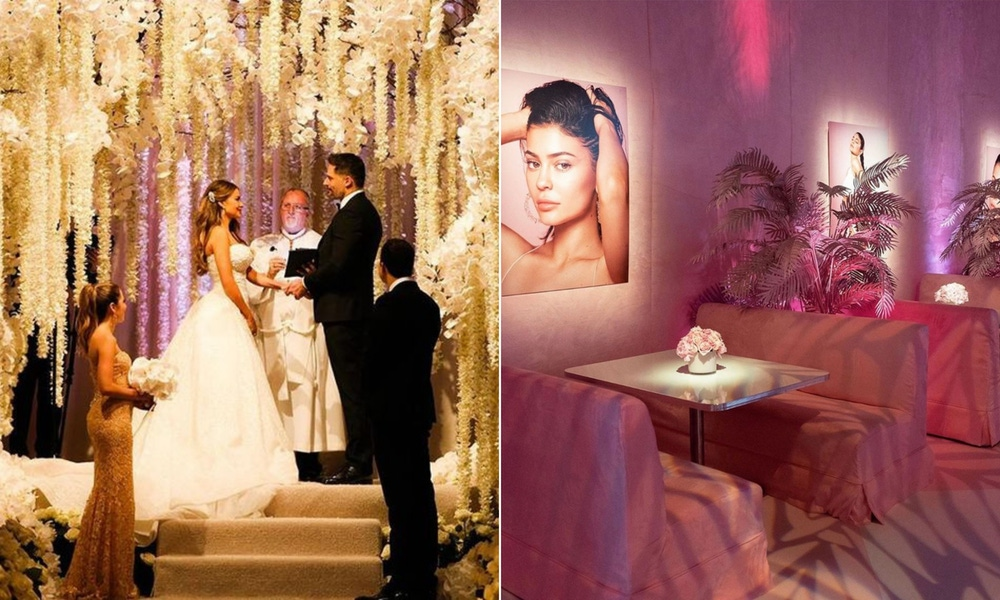 Wedding with white flowers hanging from the ceiling and pink room