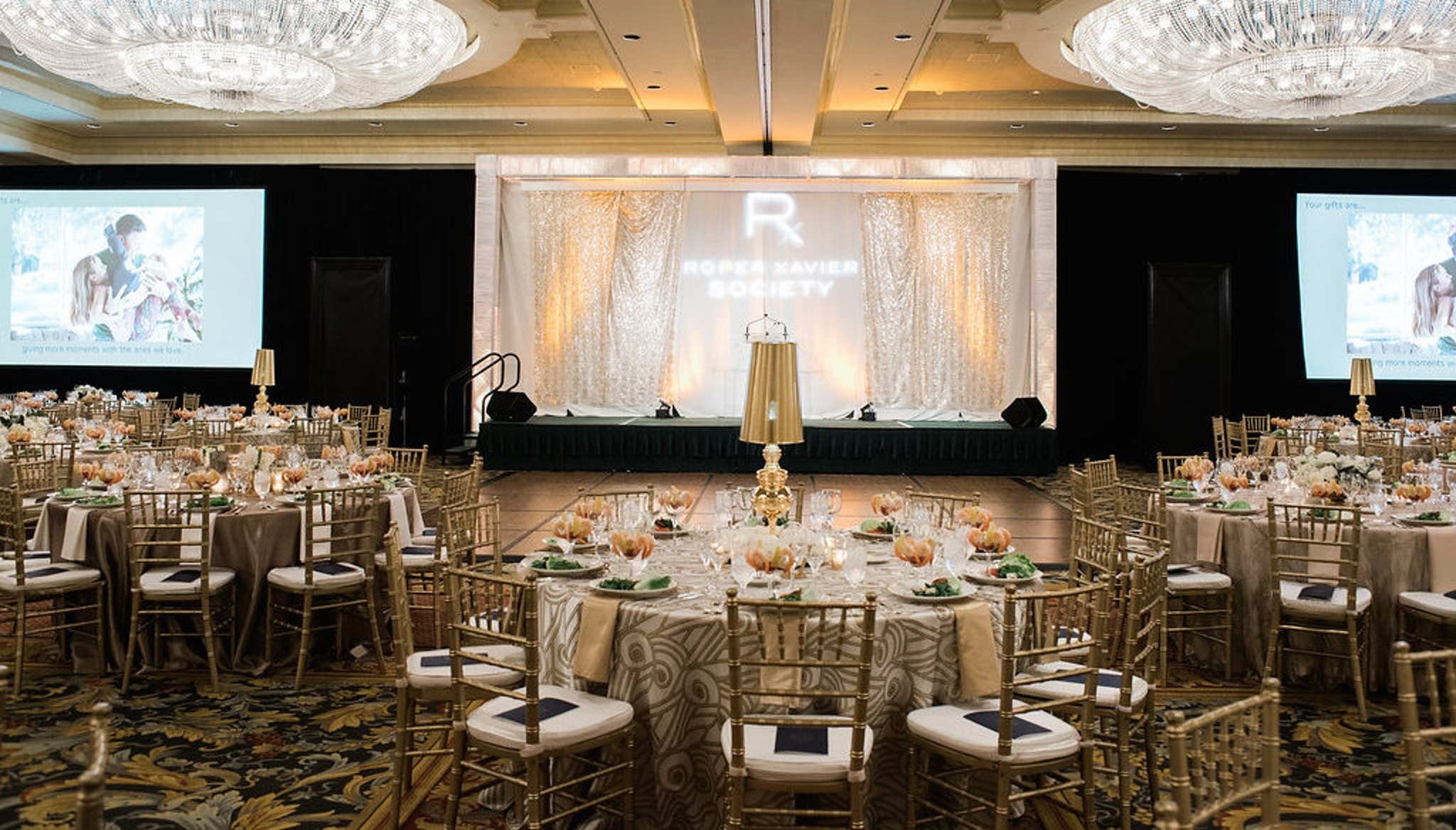 Gold decorated room with large chandeliers at the Belmond Charleston Place