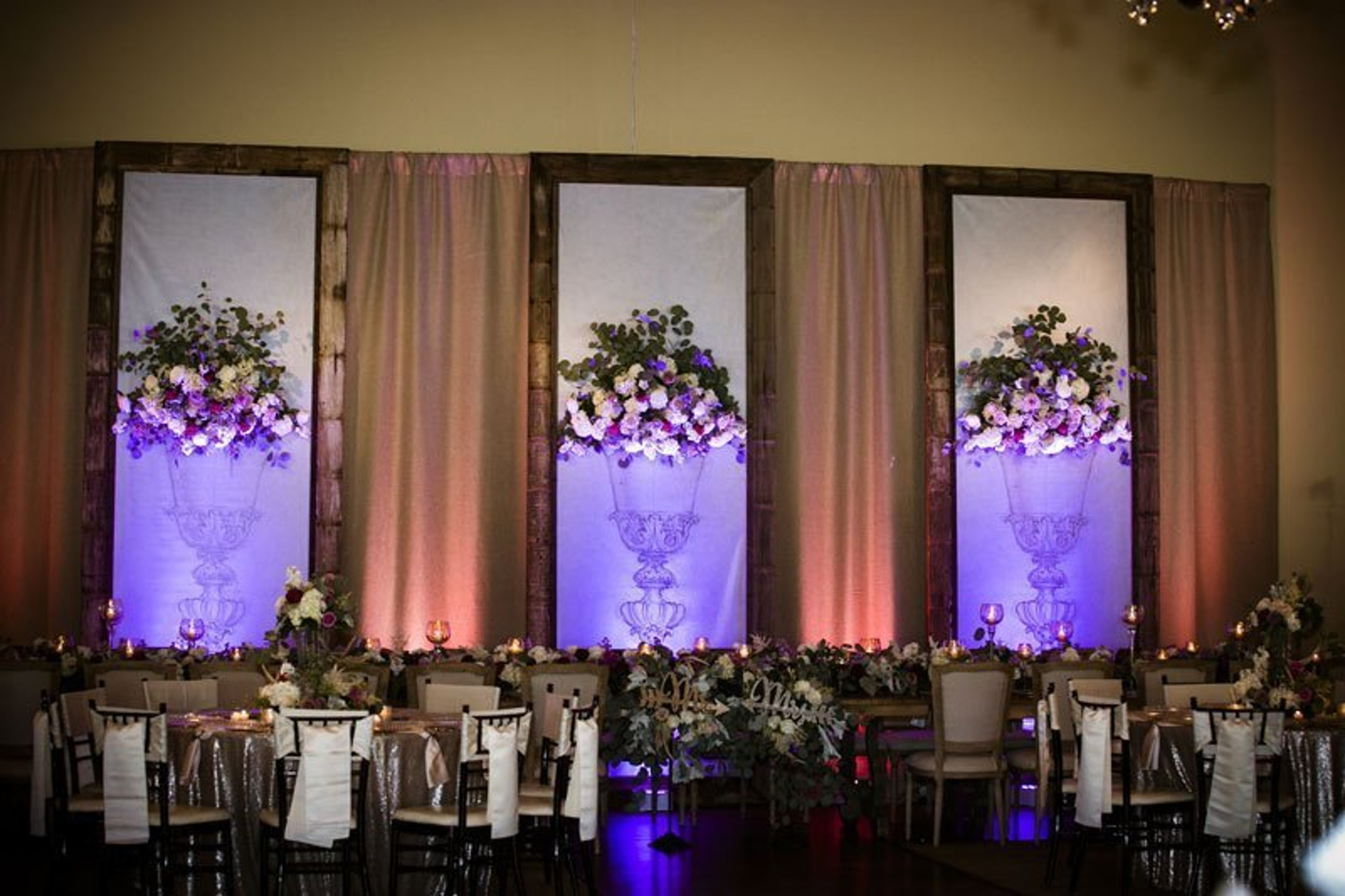 Flowered backdrop lit with purple lights at Briscoe Manor