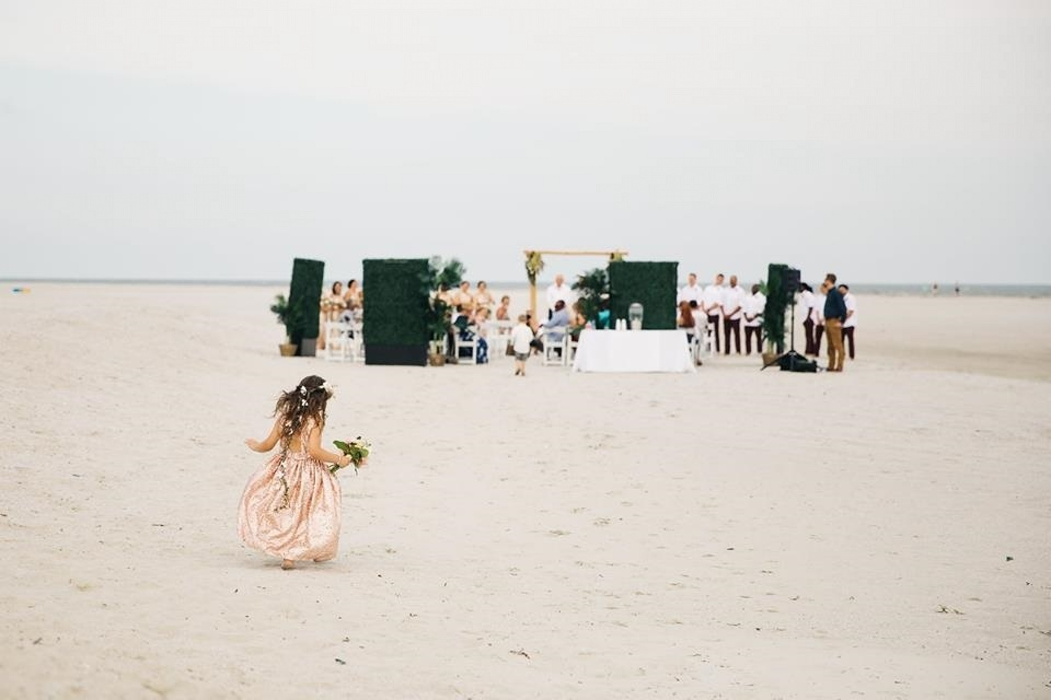 South Carolina beach wedding in front of the sunset at Wild Dunes Resort
