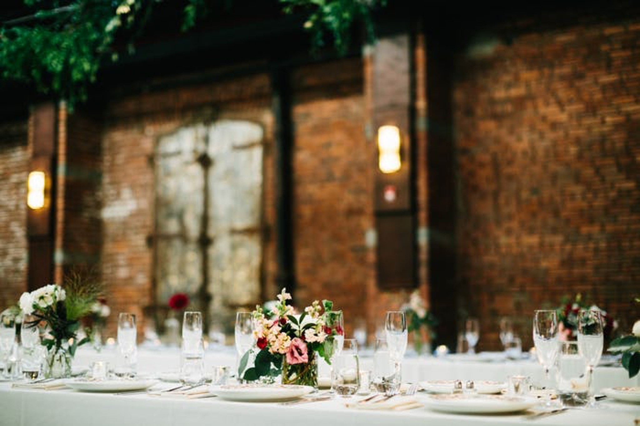 Brooklyn loft with colorful florals and glass table setting