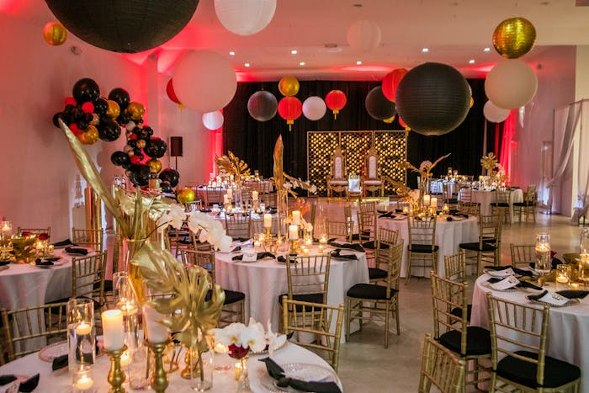White venue in New York with gold, red and black decor accents