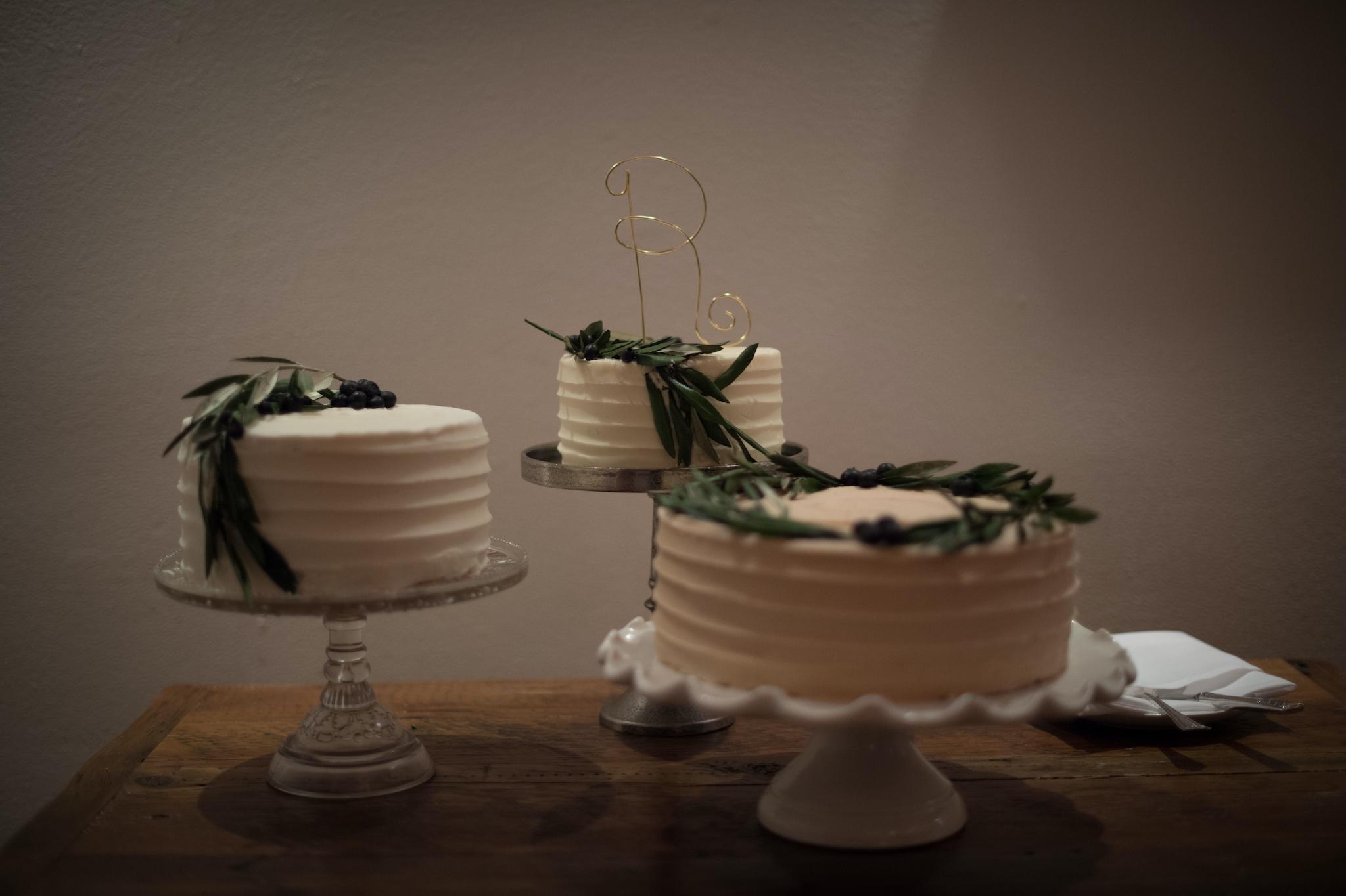 three cakes greenery