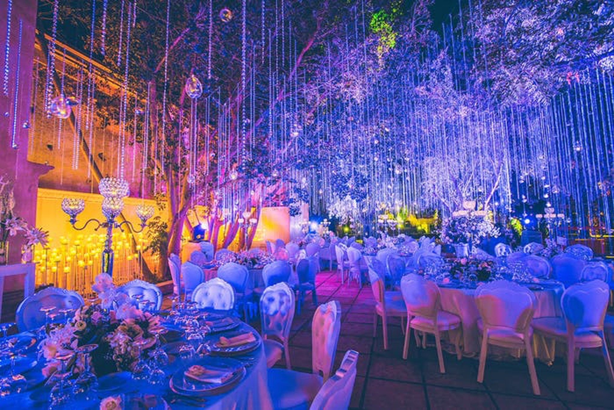 Wedding with crystal deco, neon blue lighting, and Morrocan touches