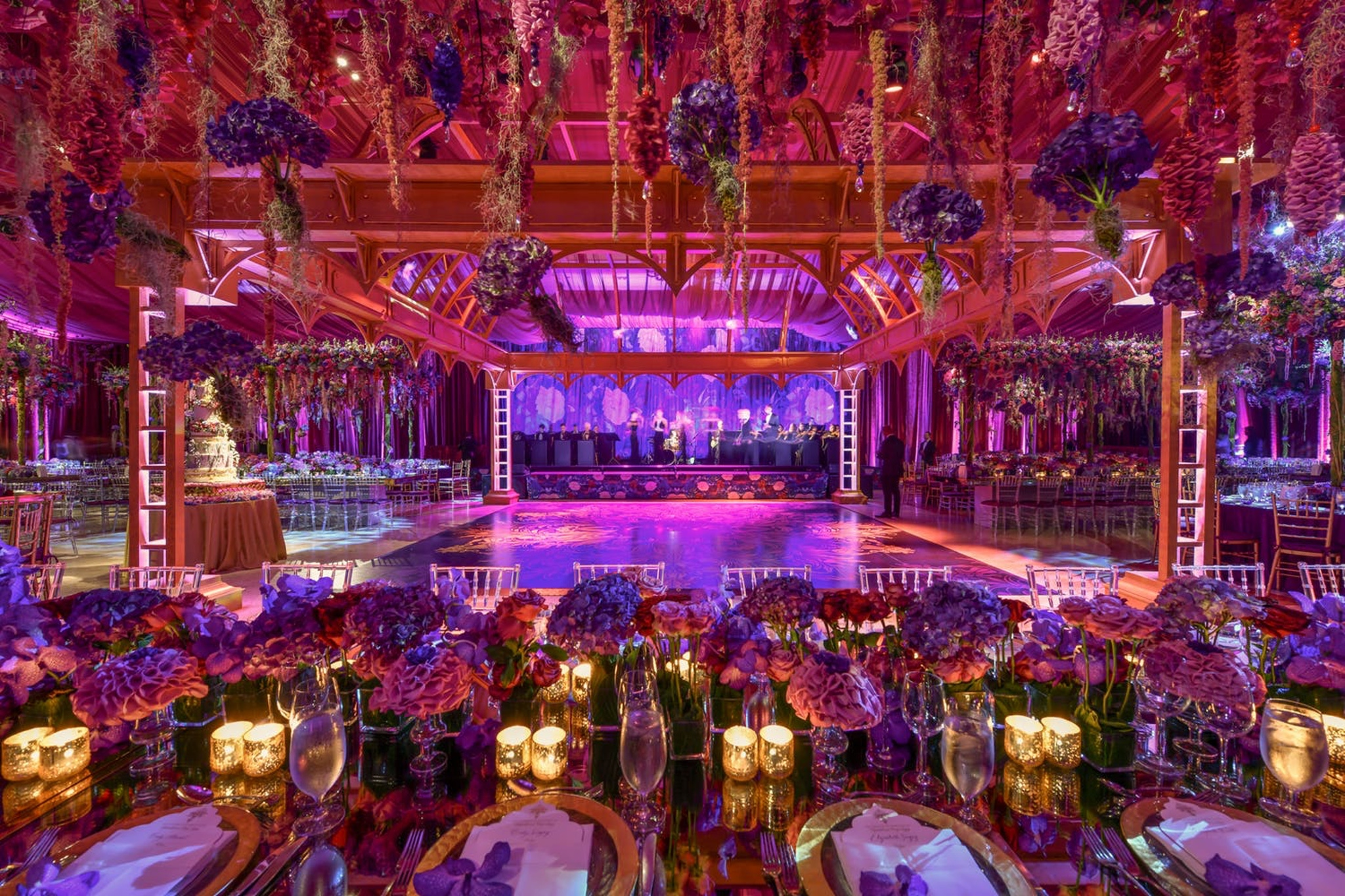 Pink, blue, and purple wedding decor accents and large dance floor at The Breakers