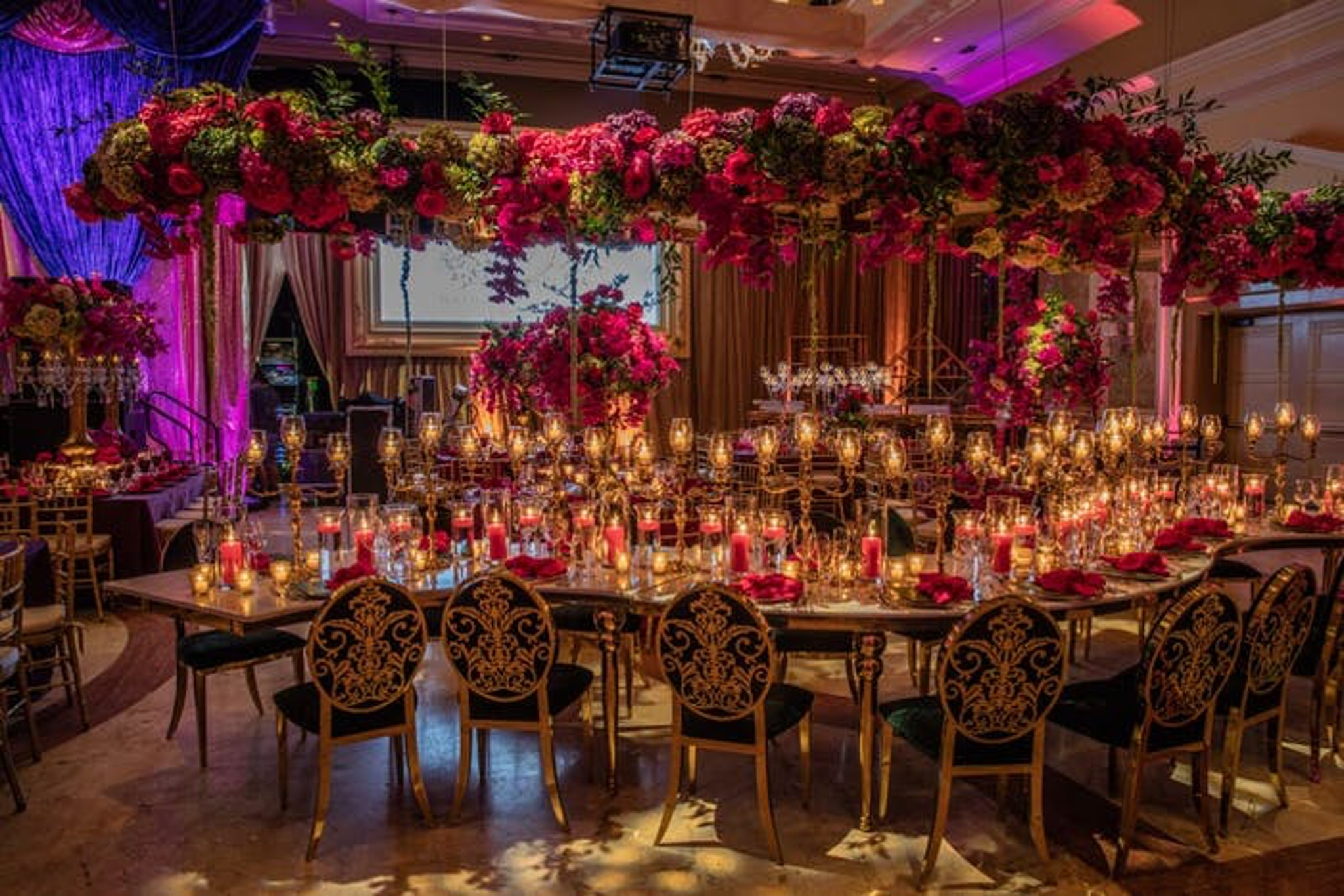 Winding wedding table with candles and colorful flowers