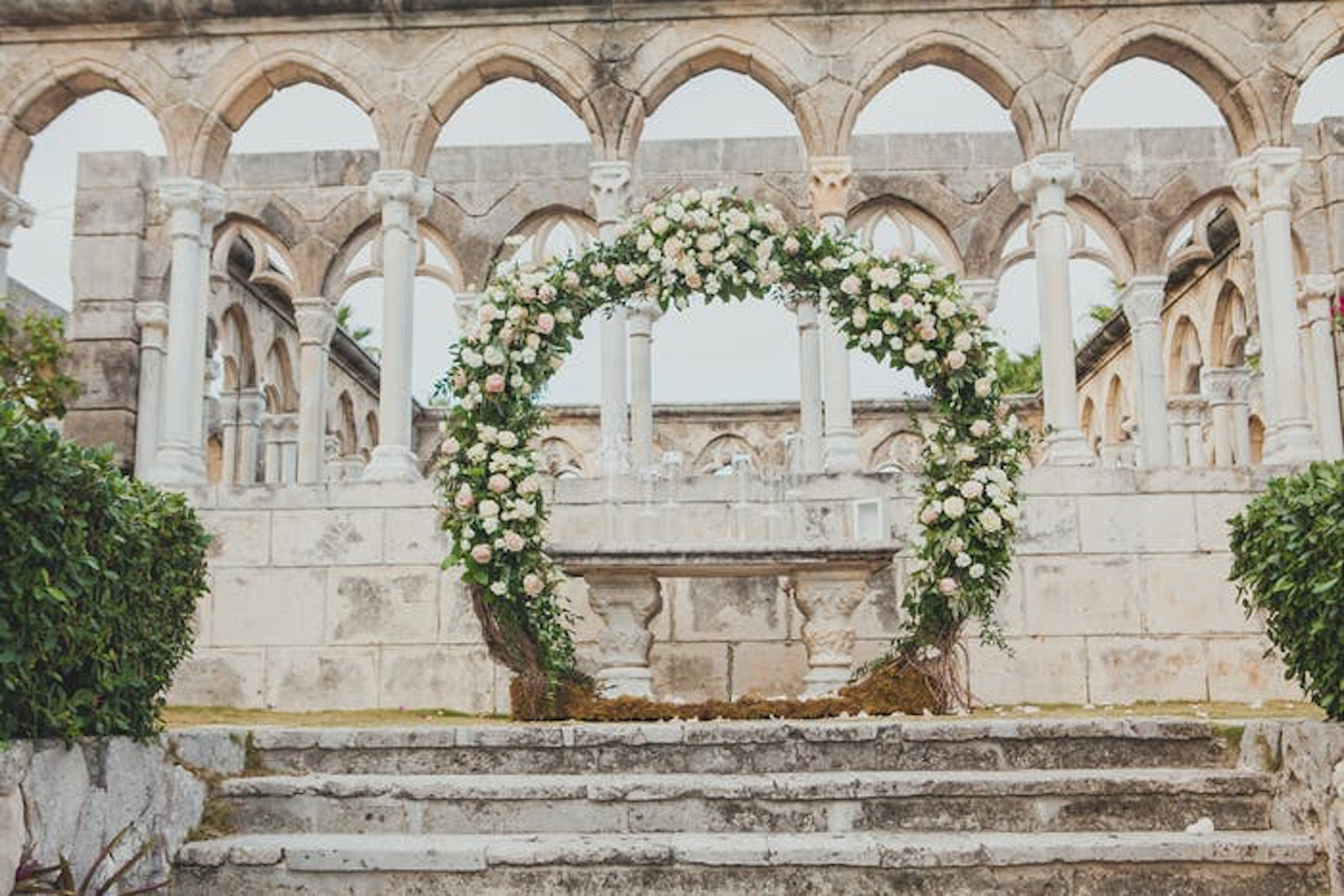 Greenery and white floral circular wedding arch