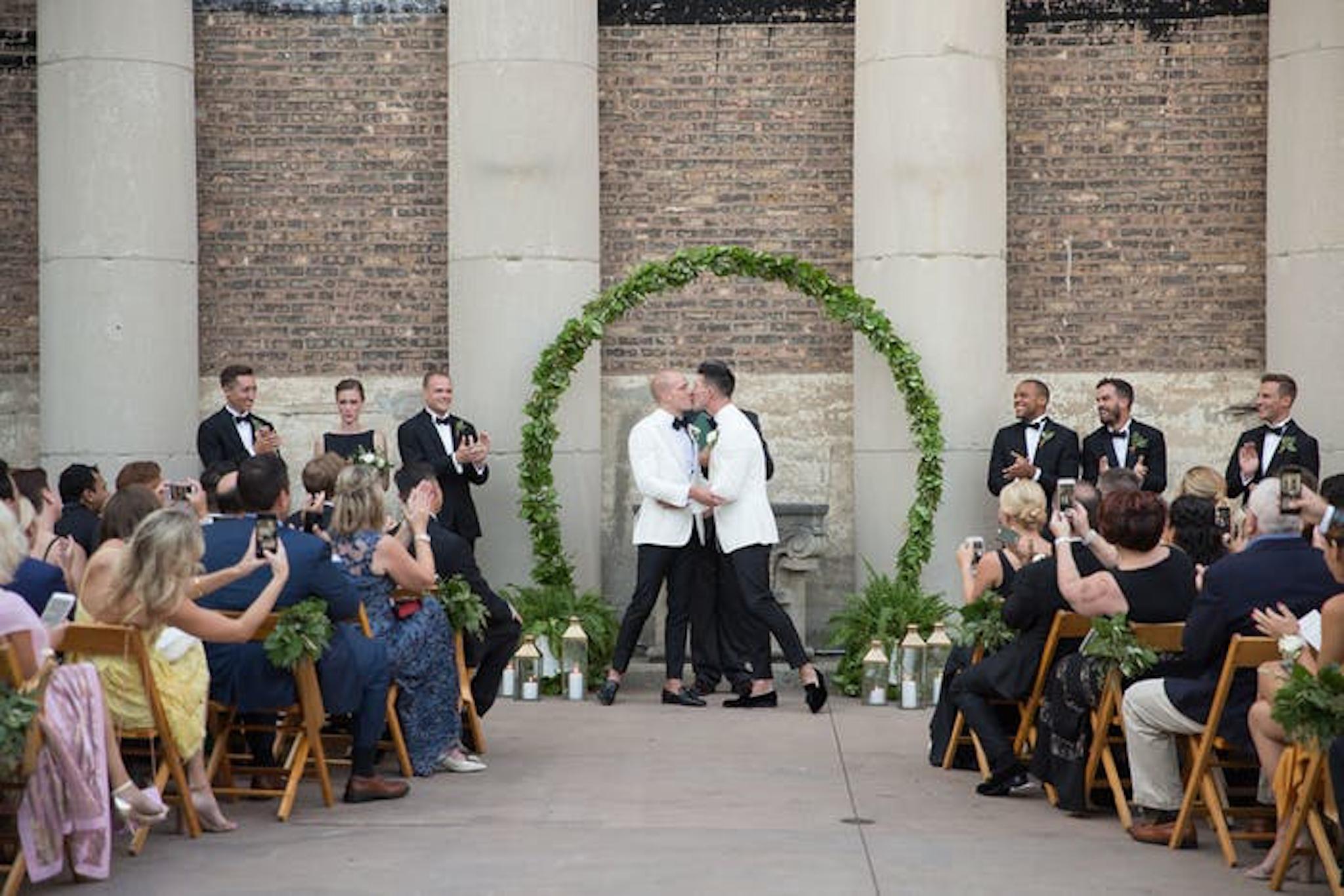 Green circular wedding arch at same sex wedding