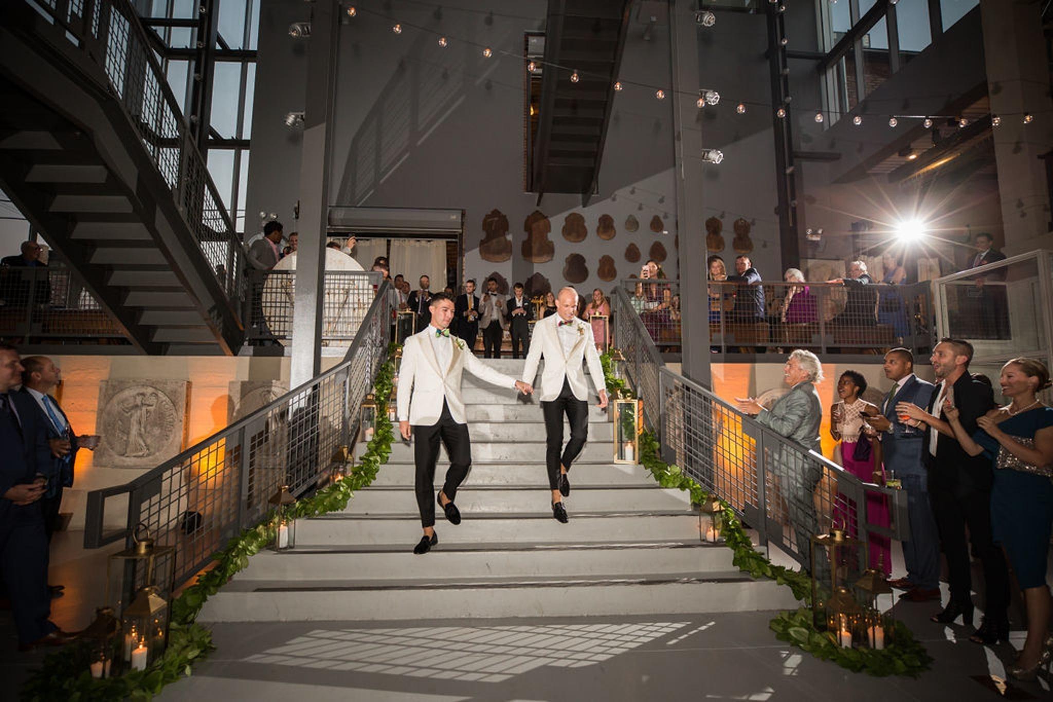 Same-sex white tuxedo wedding