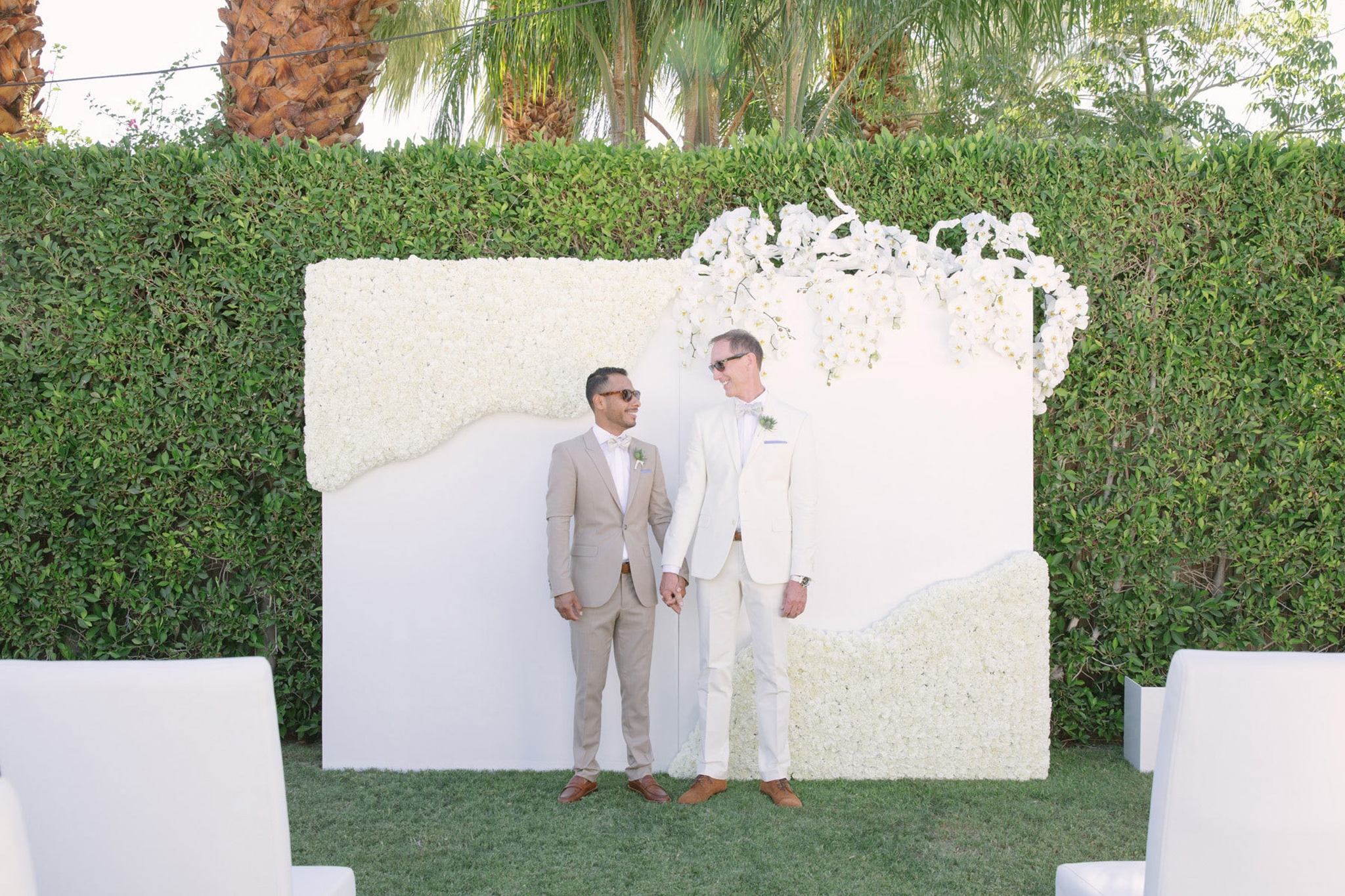 Wedding couple with green and white decor