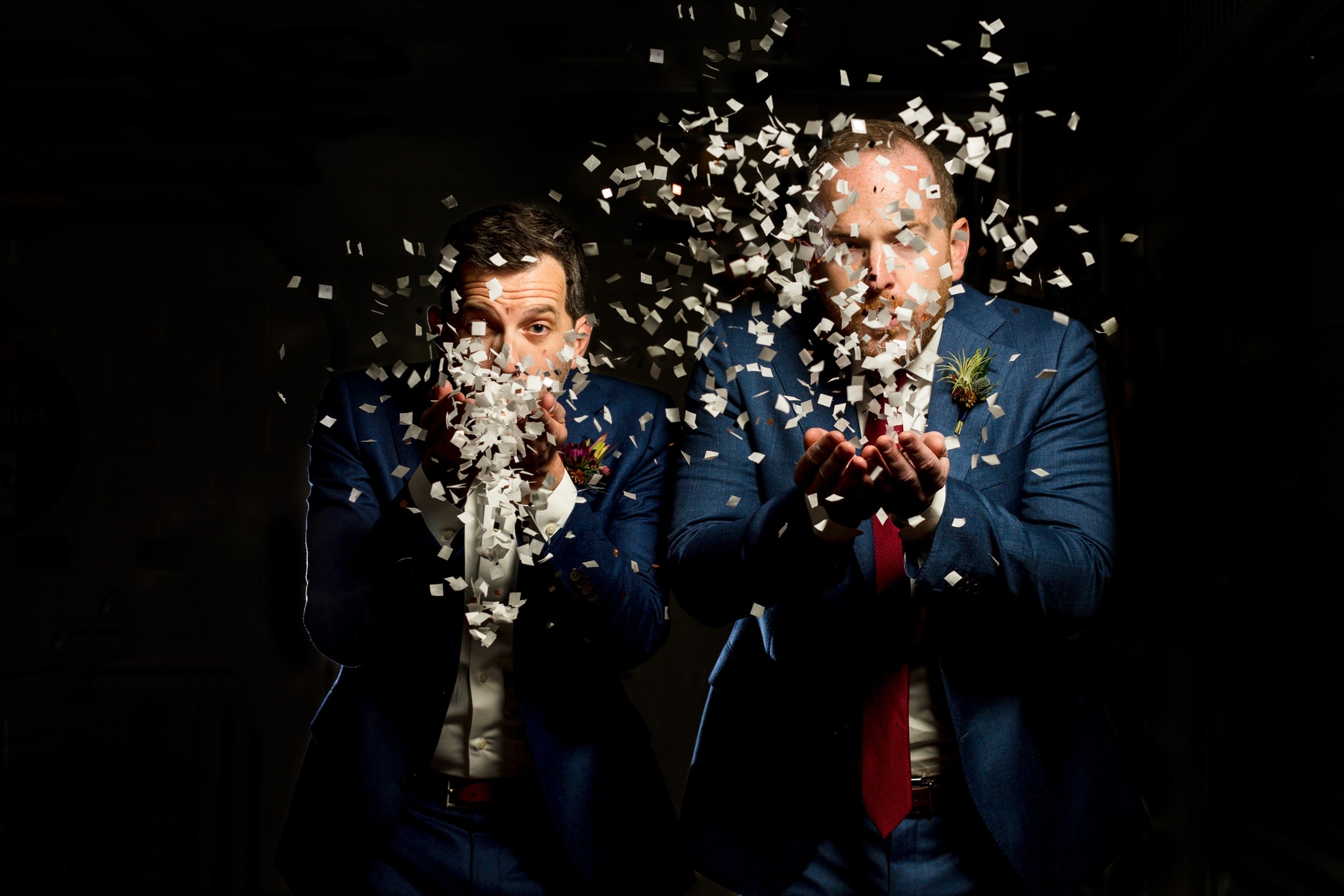 Couple blowing glitter