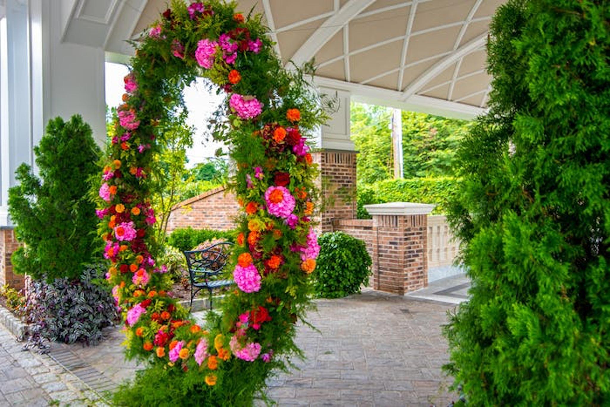 Pink, orange, and green circular wedding arch