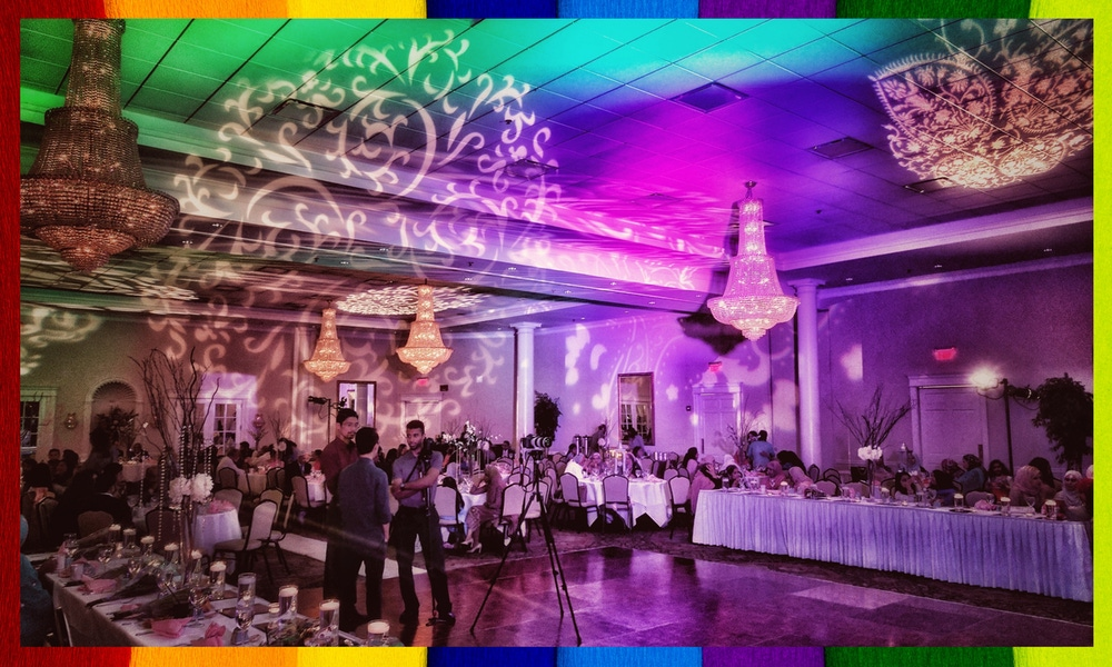 Rainbow lighting at party with crystal chandeliers