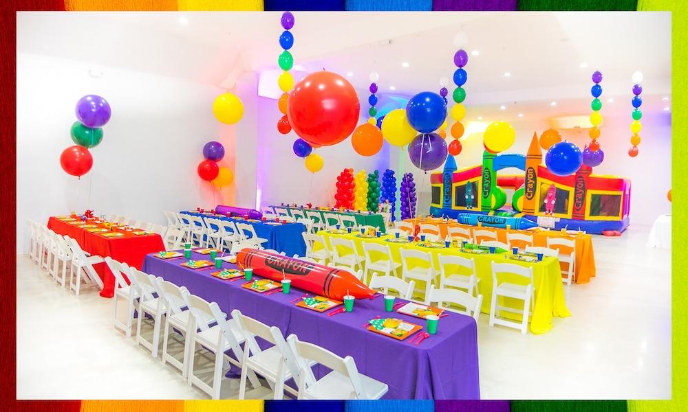 Rainbow balloons and table decor