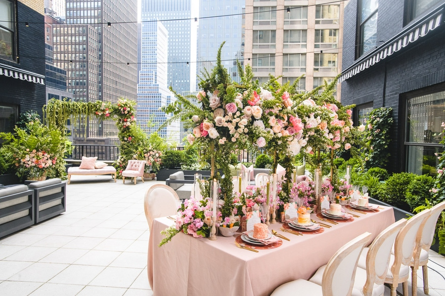 Large floral wedding centerpieces and blush tablescape