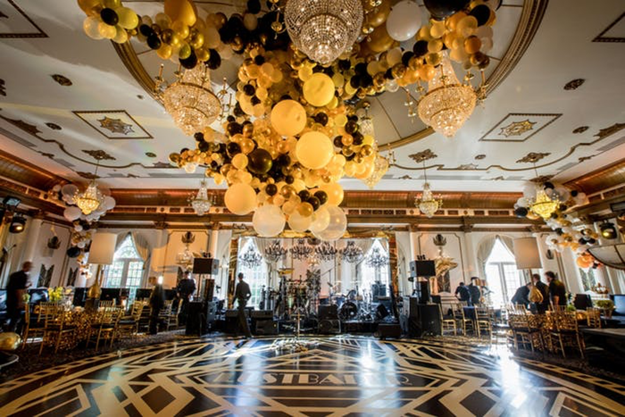 Gold and black balloons and decor