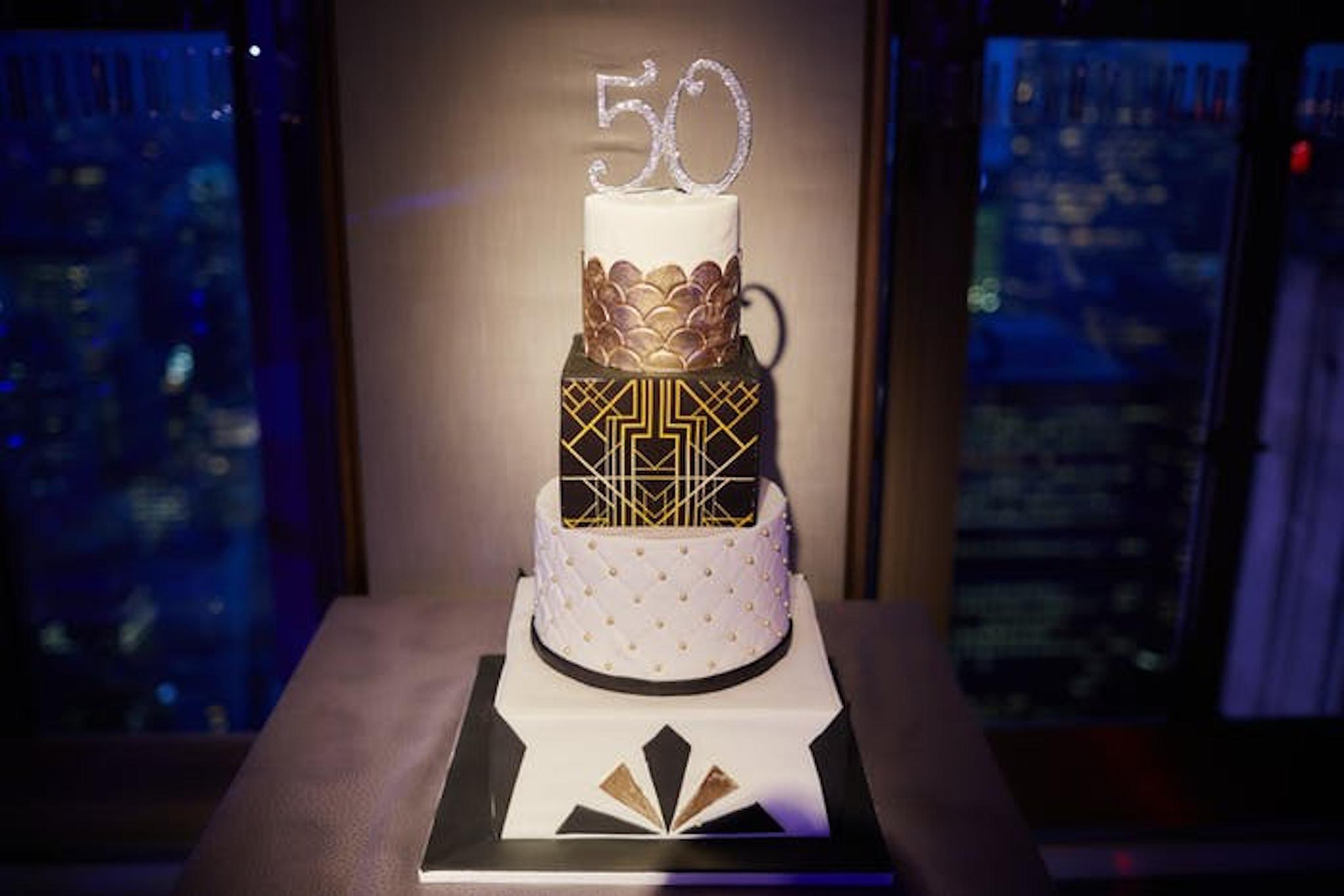 Black and gold milestone birthday cake