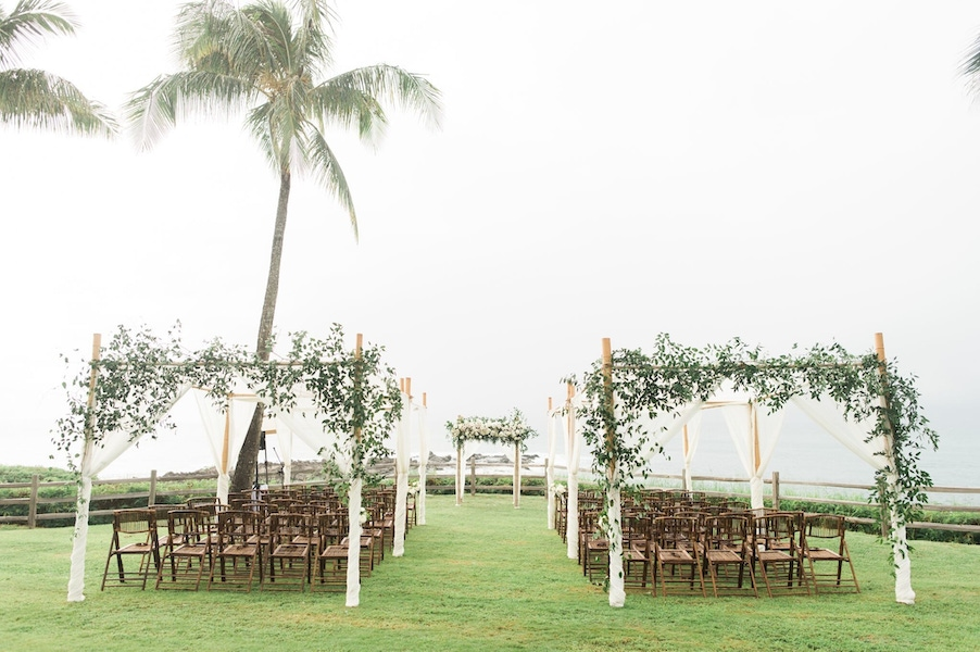 outdoor wedding with green arches
