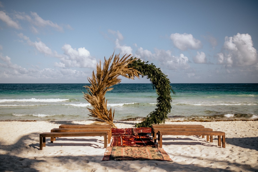 beach wedding with half greenery half pampas grass wedding arch