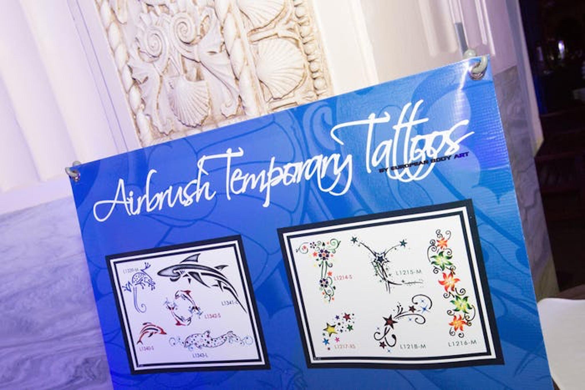 Airbrush tattoo sign