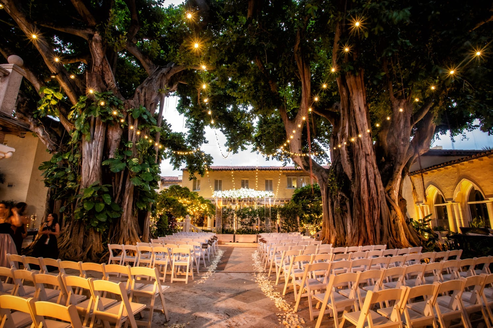 outdoor wedding ceremony with hanging lights