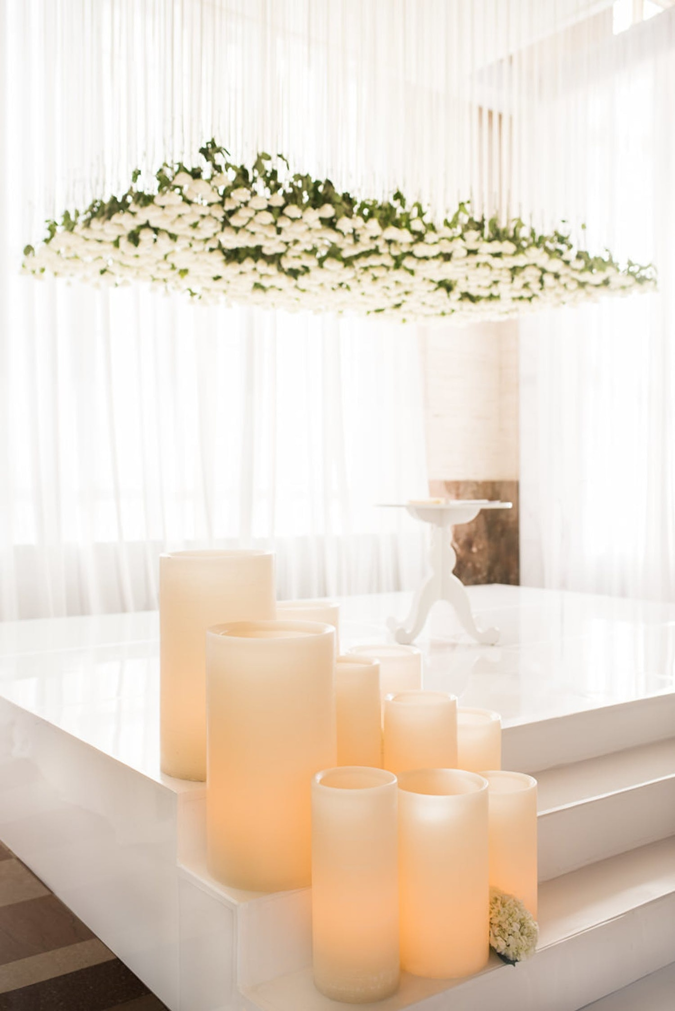 white hanging florals and candles