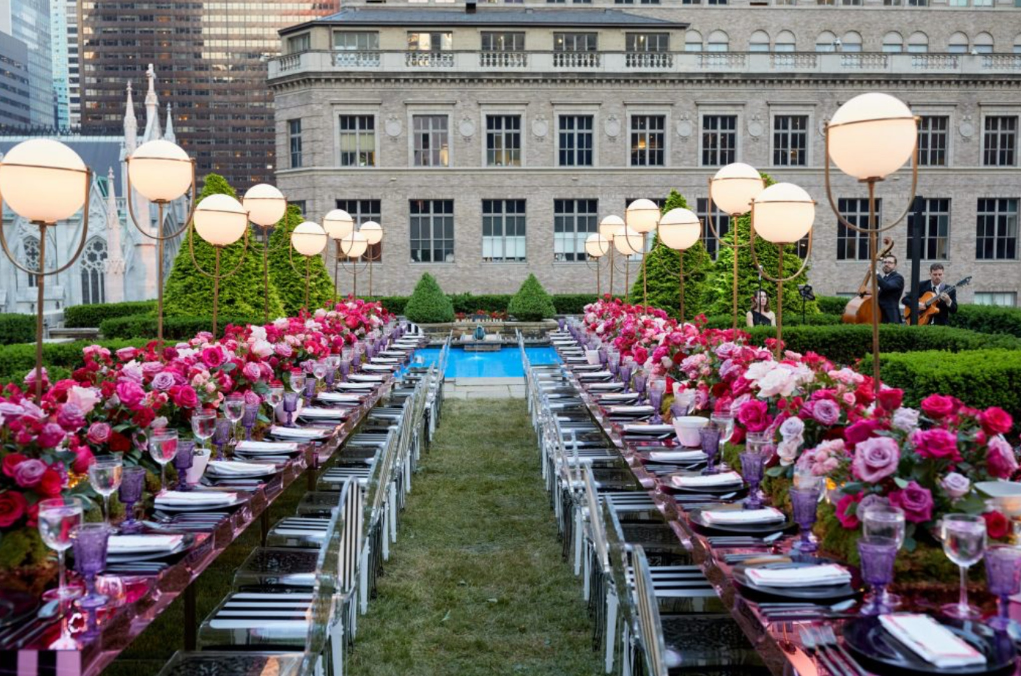 pink and purple florals on banquet tables