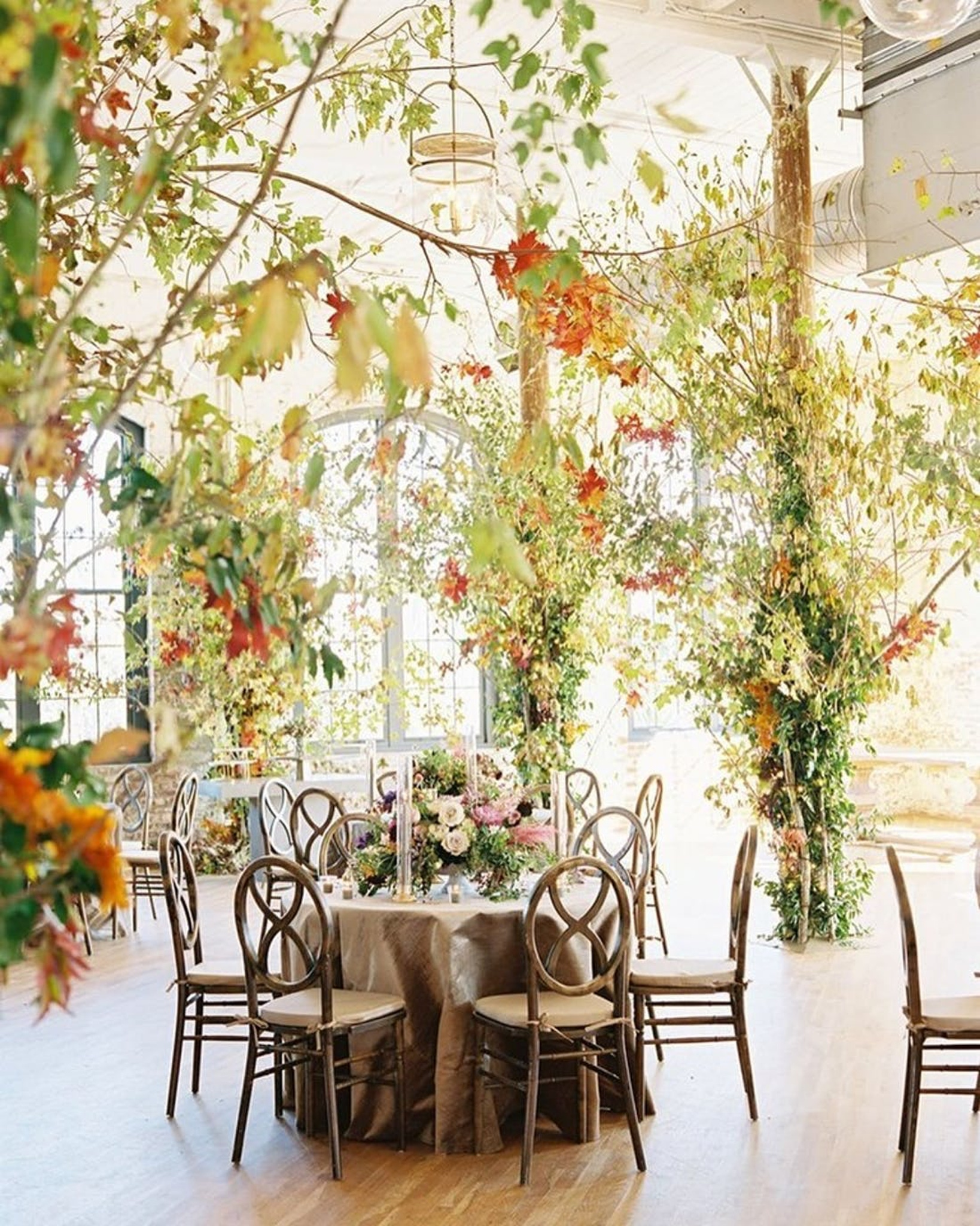 fall wedding with autumn tree and orange flowers